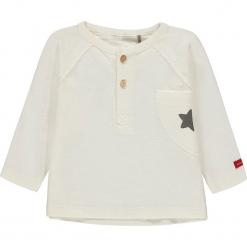Koszulka w kolorze białym. Białe bluzki dziewczęce bawełniane bellybutton, z okrągłym kołnierzem. W wyprzedaży za 37,95 zł.