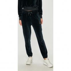 Tommy Jeans - Spodnie. Szare proste jeansy damskie marki Tommy Jeans. Za 449,90 zł.
