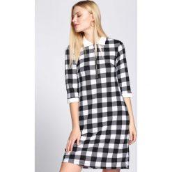 Czarna Sukienka Everybody Does. Czarne sukienki hiszpanki Born2be, l, mini, oversize. Za 49,99 zł.