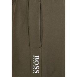 BOSS CASUAL SUPERSONIC Spodnie treningowe dark green. Zielone spodnie dresowe męskie BOSS Casual, z bawełny. Za 579,00 zł.
