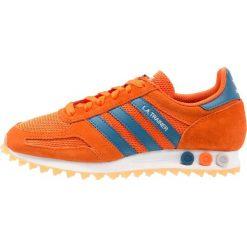Adidas Originals LA TRAINER OG Tenisówki i Trampki orange/noble teal/footwear white. Brązowe tenisówki damskie marki adidas Originals, z materiału. W wyprzedaży za 265,85 zł.