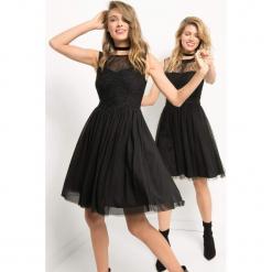 Tiulowa sukienka z brokatem. Czarne sukienki dzianinowe marki Orsay, xs, z dekoltem na plecach. Za 179,99 zł.