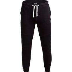 Spodnie dresowe męskie SPMD603 - CZARNY - Outhorn. Czarne spodnie dresowe męskie Outhorn, na jesień, z bawełny. W wyprzedaży za 83,99 zł.