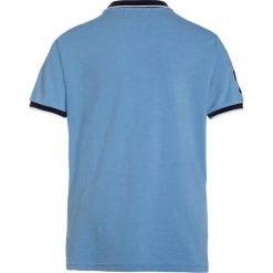 Polo Ralph Lauren Koszulka polo blue lagoon. Niebieskie bluzki dziewczęce bawełniane marki Adidas, z kontrastowym kołnierzykiem, z krótkim rękawem. Za 319,00 zł.