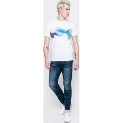 G-Star Raw - Jeansy 5620. Niebieskie jeansy męskie z dziurami marki G-Star RAW. W wyprzedaży za 399,90 zł.