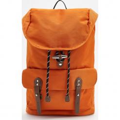 Plecak z kieszenią na laptopa - Pomarańczo. Pomarańczowe plecaki męskie Reserved. Za 139,99 zł.