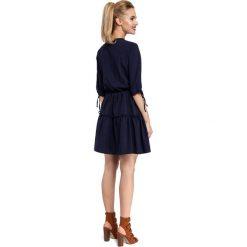 CAMILLE Gładka sukienka w stylu boho - granatowa. Niebieskie sukienki boho marki numoco, na imprezę, s, w kwiaty, z jeansu, sportowe. Za 159,90 zł.