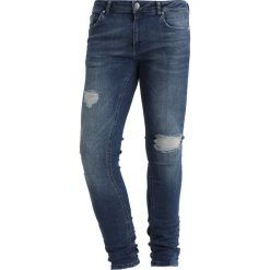 Criminal Damage SPRAY Jeans Skinny Fit medium blue. Niebieskie rurki męskie marki Criminal Damage. Za 249,00 zł.
