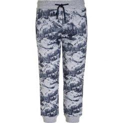 Timberland Spodnie treningowe meliertes grau. Szare spodnie chłopięce Timberland, z bawełny. W wyprzedaży za 173,40 zł.