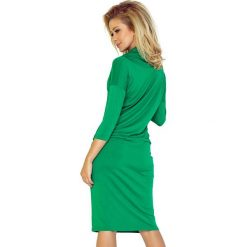 Chantal Sukienka sportowa z golfem - zielony. Zielone sukienki sportowe marki numoco, z wiskozy, z golfem, sportowe. Za 110,00 zł.
