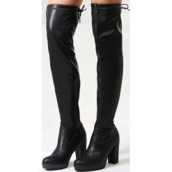 Czarne Kozaki More Strength. Czarne buty zimowe damskie marki Kazar, z futra, przed kolano, na wysokim obcasie, na koturnie. Za 159,99 zł.