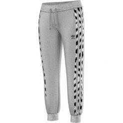 Adidas Spodnie Zebra Flock szare r. 42 (M30507). Szare spodnie sportowe damskie marki Adidas, m, z motywem zwierzęcym. Za 155,06 zł.