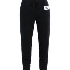 Calvin Klein Jeans PERSIS TRUE ICON TRACK PANT Spodnie treningowe black. Czarne spodnie sportowe damskie Calvin Klein Jeans, s, z bawełny. Za 449,00 zł.