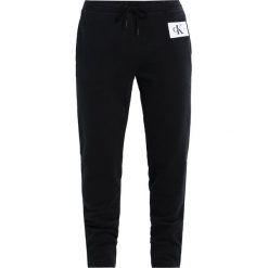 Boyfriendy damskie: Calvin Klein Jeans PERSIS TRUE ICON TRACK PANT Spodnie treningowe black
