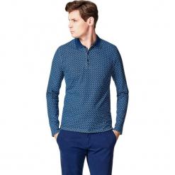 Koszulka polo w kolorze ciemnoniebieskim. Niebieskie koszulki polo marki Vistula, l, w kropki, z długim rękawem. W wyprzedaży za 149,95 zł.