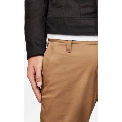 G-Star Raw - Spodnie Bronson. Szare chinosy męskie marki G-Star RAW, z bawełny. W wyprzedaży za 269,90 zł.