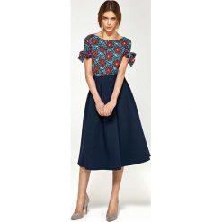 Bluzka z Wiązaniem na Rękawie - Kwiaty. Czerwone bluzki na imprezę Molly.pl, l, w kwiaty, z tkaniny, eleganckie, z krótkim rękawem. Za 108,90 zł.
