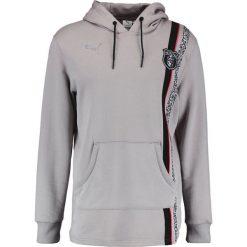 Puma TRAPSTAR Bluza z kapturem ash. Szare bluzy męskie rozpinane marki Puma, m, z bawełny, z kapturem. W wyprzedaży za 381,75 zł.