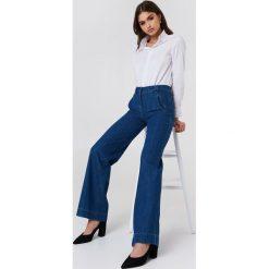 Spodnie damskie: Trendyol Jeansy dzwony z wysokim stanem - Blue