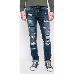 Guess Jeans - Jeansy. Szare jeansy męskie skinny marki Guess Jeans, l, z aplikacjami, z bawełny. W wyprzedaży za 269,90 zł.