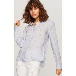 Koszula o klasycznym fasonie - Niebieski. Niebieskie koszule damskie marki Reserved, klasyczne, z klasycznym kołnierzykiem. Za 59,99 zł.