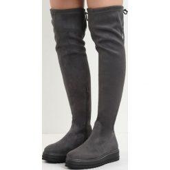 Ciemnoszare Kozaki Marengo. Czarne buty zimowe damskie marki Kazar, z futra, przed kolano, na wysokim obcasie, na koturnie. Za 109,99 zł.