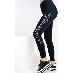 Legginsy we wzory: Czarne legginsy z napisem