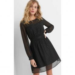 Sukienka w groszki. Czarne sukienki na komunię marki Orsay, na co dzień, w grochy, z elastanu, na ramiączkach, midi, rozkloszowane. Za 139,99 zł.