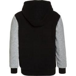 Rip Curl WAFFLE Kurtka przejściowa black. Czarne kurtki chłopięce przejściowe marki Rip Curl, z bawełny. W wyprzedaży za 231,20 zł.
