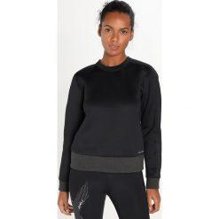 Under Armour LUSTER LONG SLEEVE CREW Bluza black. Czarne bluzy sportowe damskie marki Under Armour, l, z bawełny. W wyprzedaży za 381,75 zł.