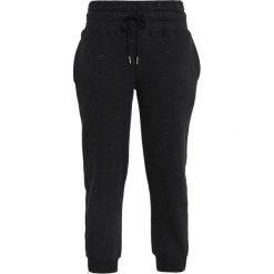 Adidas by Stella McCartney ESSENTIAL PANTS Spodnie treningowe black storm mel. Czarne bryczesy damskie adidas by Stella McCartney, xs, z bawełny. Za 379,00 zł.