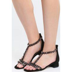 Czarne Sandały Shrewdness. Czarne sandały damskie marki Born2be, z materiału, na wysokim obcasie, na obcasie. Za 69,99 zł.