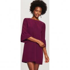 Sukienka z ozdobnymi rękawami - Fioletowy. Fioletowe sukienki z falbanami marki Reserved. Za 99,99 zł.