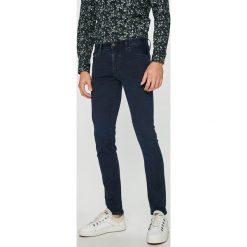 Armani Exchange - Jeansy. Niebieskie jeansy męskie skinny Armani Exchange, z bawełny. Za 599,90 zł.