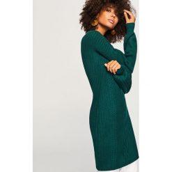 Długi sweter - Khaki. Brązowe swetry klasyczne damskie marki DOMYOS, xs, z bawełny. Za 139,99 zł.