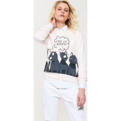 Bluzy damskie: Bluza z kotami – Różowy