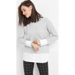 Sweter z koszulowymi wstawkami. Czarne swetry klasyczne damskie marki Orsay, xs, z bawełny, z dekoltem na plecach. Za 119,99 zł.