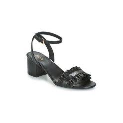 Sandały MICHAEL Michael Kors  BELLA FLEX MID. Czarne sandały damskie marki MICHAEL Michael Kors, z gumy, przed kolano, na wysokim obcasie. Za 639,00 zł.