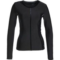 Puma NOCTURNAL Koszulka sportowa black. Czarne topy sportowe damskie marki Puma, m, z elastanu. W wyprzedaży za 254,25 zł.