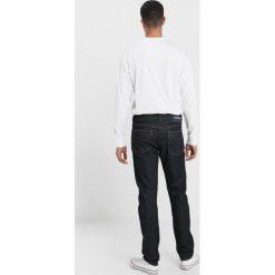 Calvin Klein Jeans 026 SLIM FIT Jeansy Slim Fit antwerp rinse. Niebieskie jeansy męskie relaxed fit Calvin Klein Jeans. Za 419,00 zł.