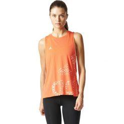 Adidas Koszulka  Logo TR pomarańczowa r. L (BP8412). Brązowe topy sportowe damskie Adidas, l. Za 102,29 zł.