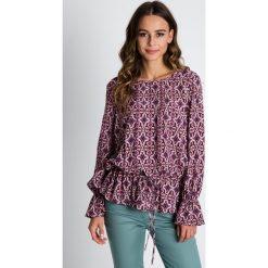 Bluzki asymetryczne: Luźna bluzka z wiązaniem w talii BIALCON