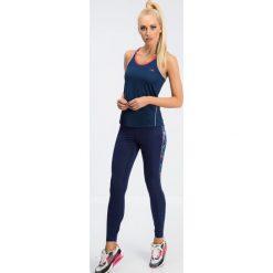 Granatowe legginsy sportowe z kolorowymi lampasami 12613. Szare legginsy sportowe damskie marki Fasardi, l, w kolorowe wzory. Za 59,00 zł.