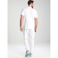 Nike Performance HERITAGE  Koszulka polo white/black. Białe koszulki polo Nike Performance, l, z bawełny. Za 179,00 zł.