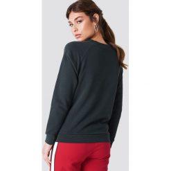 Levi's Luźna bluza Graphic Crew - Black. Brązowe bluzy damskie marki Levi's®, z obniżonym stanem. Za 242,95 zł.