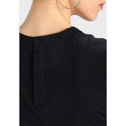 GStar DUNDJA SUIT S/LESS Kombinezon  black. Czarne kombinezony damskie marki G-Star, s, z elastanu. W wyprzedaży za 479,20 zł.