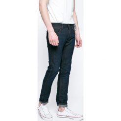 Wrangler - Jeansy Spencer. Niebieskie jeansy męskie slim Wrangler, z aplikacjami, z bawełny. Za 339,90 zł.