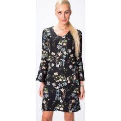 Sukienka w kwiaty czarna 6519. Czarne sukienki Fasardi, s, w kwiaty. Za 54,00 zł.