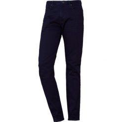 Emporio Armani Jeansy Slim Fit denim blu. Niebieskie jeansy męskie relaxed fit Emporio Armani, z bawełny. Za 639,00 zł.