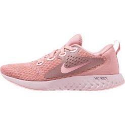 Nike Performance LEGEND REACT Obuwie do biegania treningowe rust pink/pink tint/smokey mauve/sail. Czerwone buty do biegania damskie marki Nike Performance, z materiału. Za 419,00 zł.